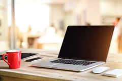 Laptop with blank black screen on table  office. Laptop with blank black screen on table in shop office background Stock Image