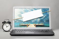 Laptop with blank note Stock Photo