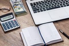 Laptop, blank, notepad  calculator  dollar pen on desk. Laptop, blank  notepad  calculator  dollar, pen on desk Stock Photography