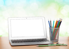 Laptop with blank screen and colorful pencils Stock Photo
