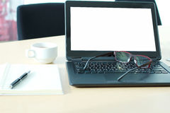 Laptop with blank screen on desk in Conference room. Royalty Free Stock Photography