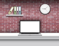 Laptop with blank screen on desk in home interior. Royalty Free Stock Image
