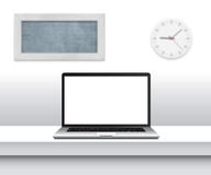 Laptop with blank screen on desk in minimalistic office interior. Royalty Free Stock Photo