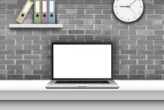 Laptop with blank screen on desk in office interior. Stock Photo