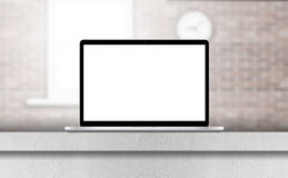 Laptop, with blank screen on desk in office interior. Stock Photos