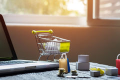 Laptop blank screen and hopping cart full of gifts with copyspac. E, online shopping concept royalty free stock photo