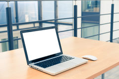 Laptop blank screen in the library and office Royalty Free Stock Images