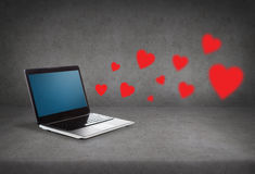Laptop with blank screen and red hearts Royalty Free Stock Photography