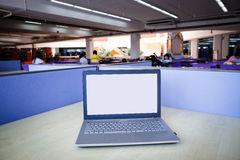 Laptop with blank screen on table. Stock Photography
