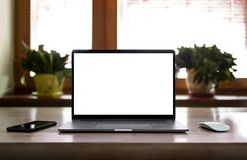 Laptop with blank screen on table Stock Photo