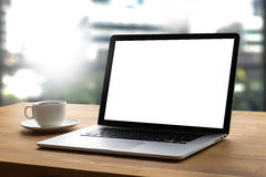 Laptop with blank screen on table interior, man at his workplace Stock Photos