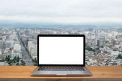 Laptop with blank screen on table. With Kyoto Japan backgraound royalty free stock images