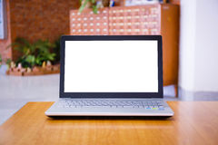 Laptop with blank screen on the table in library.  Royalty Free Stock Photo