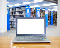 Laptop with blank screen on the table in library Stock Image