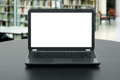 Laptop with blank screen on the table in library Royalty Free Stock Photography