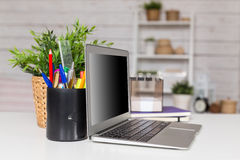 Laptop with blank screen. On table in office room royalty free stock photos