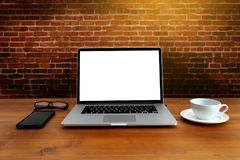 Laptop with blank screen on table. Workspace background new project on laptop computer with blank copy space screen for your. Advertising text message royalty free stock photo