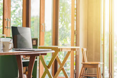 Laptop blank screen on wooden desk stock photos