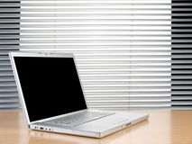 Laptop and blinds Royalty Free Stock Image