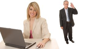 Laptop Blond and Senior Executive. Laptop computer with a lovely blond and a senior executive in the background Royalty Free Stock Images
