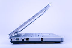 Laptop in blue. Half opened laptop from the side Royalty Free Stock Photos