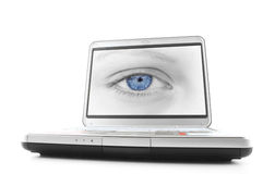 Laptop blue eye. Laptop with a picture of a blue eyed female stock photography