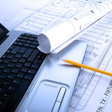 Laptop and blue prints royalty free stock photo