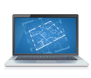 Laptop with blueprint Royalty Free Stock Image