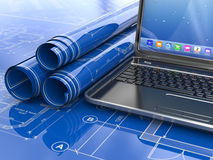 Laptop and blueprint with house project. Royalty Free Stock Images