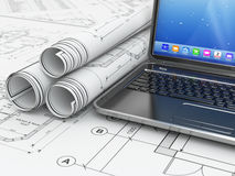 Laptop and blueprint with house project. Royalty Free Stock Image