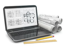 Laptop and blueprint with house project. Royalty Free Stock Photo