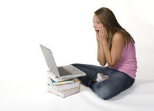 Laptop blunder. Shocked teenage girl loses her work on computer Stock Photography