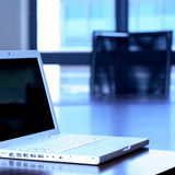 Laptop on boardroom table Stock Images