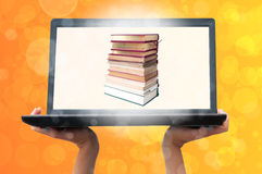 Laptop and book Royalty Free Stock Photos
