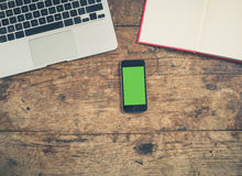 Laptop, book and smart phone Royalty Free Stock Photo
