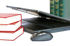Laptop and books. Isolated on a white background Royalty Free Stock Photography