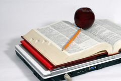 Laptop, books and apple royalty free stock photo