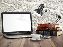 Laptop with books and coffee cup on the vintage desk. Modern sty. Lish workspace. 3d Stock Photography