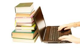 The laptop and books, encyclopedias Royalty Free Stock Photos