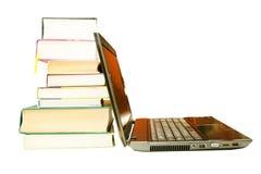 The laptop and books, encyclopedias Stock Photos
