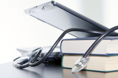 Laptop, books and medical stethoscope. Stock Images