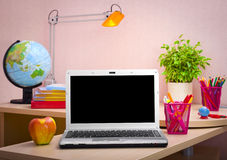Laptop, books and school supplies. Education concept Stock Photography