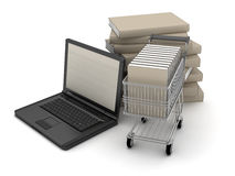 Laptop and books in shopping cart Stock Photos