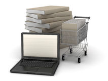 Laptop, books and shopping cart Stock Images
