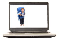 Laptop Boy. Laptop computer with a boy wearing a backpack on the screen Stock Image