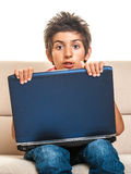 Laptop boy shocked Stock Photos
