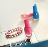 Laptop, bracelet and nail polish Royalty Free Stock Photos