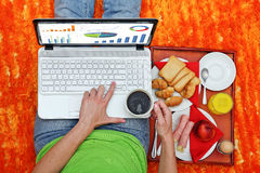 Laptop and breakfast Stock Images