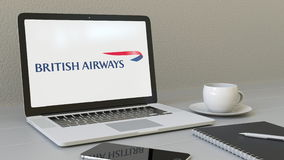 Laptop with British Airways logo on the screen. Modern workplace conceptual editorial 3D rendering. Laptop with British Airways logo on the screen. Modern stock illustration