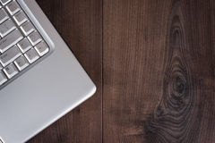 Laptop on brown wooden background Stock Photos